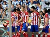 Atletico Madrid's David Villa is congratulated by team mates after scoring his team's opening goal against Real Sociedad on September 1, 2013