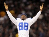 Wide receiver Dez Bryant #88 of the Dallas Cowboys calls for a touchdown on a reach into the endzone by Anthony Amos against the Oakland Raiders in the fourth quarter of a preseason game on August 9, 2013