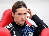 Fernando Torres sitting on the bench during Chelsea's match with Sunderland in 2011.