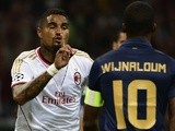 Milan's Kevin Prince Boateng taunts PSV captain George Wijnaldum after a goal on August 28, 2013