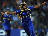 Sri Lanka fast bowler Lasith Malinga reacts after taking the wicket of India batsman Sachin Tendulkar during the ICC Cricket World Cup Final on April 2, 2011