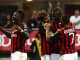 Milan's Mario Balotelli is congratulated by team mates after scoring his team's third goal against Cagliari on September 1, 2013