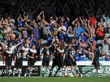 Tendayi Darikwa of Chesterfield celebrates with team-mates after scoring their second goal during the Sky Bet League Two match between Portsmouth and Chesterfield at Fratton Park on August 31, 2013