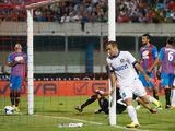 Inter's Rodrigo Palacio celebrates after scoring the opening goal against Catania on September 1, 2013