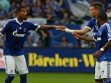 Schalke's midfielder Kevin Prince Boateng, Schalke's Peruvian striker Jefferson Farfan and Schalke's striker Adam Szalai celebrate scoring during the German first division Bundesliga football match FC Schalke 04 vs Bayer Leverkusen in the western German c