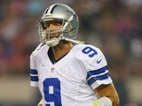 Tony Romo #9 of the Dallas Cowboys during a preseason game at AT&T Stadium on August 24, 2013