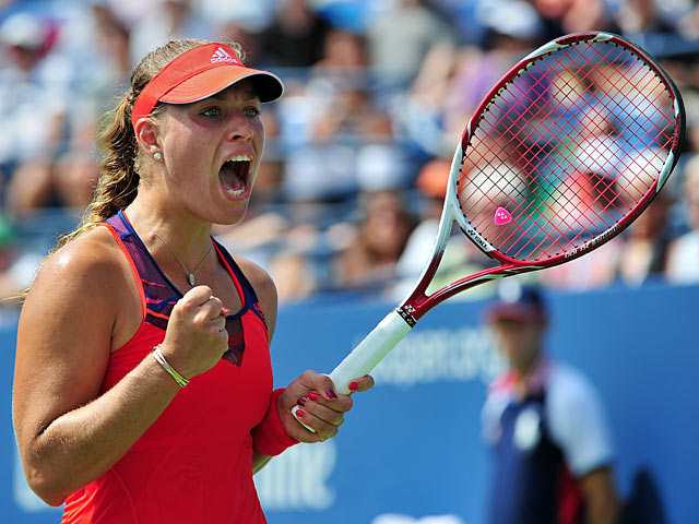 Angelique Kerber celebrates her win against Eugenie Bouchard during the second round of the US Open on August 29, 2013