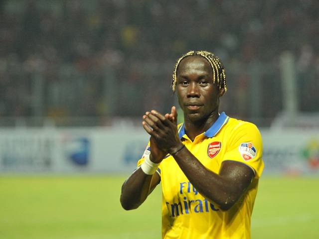 Arsenal defender Bacary Sagna applauds the fans after a pre-season game in Indonesia on July 14, 2013