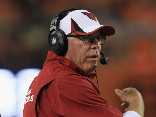 Head coach Bruce Arians of the Arizona Cardinals leads his team against the Denver Broncos during preseason action at Sports Authority Field at Mile High on August 29, 2013