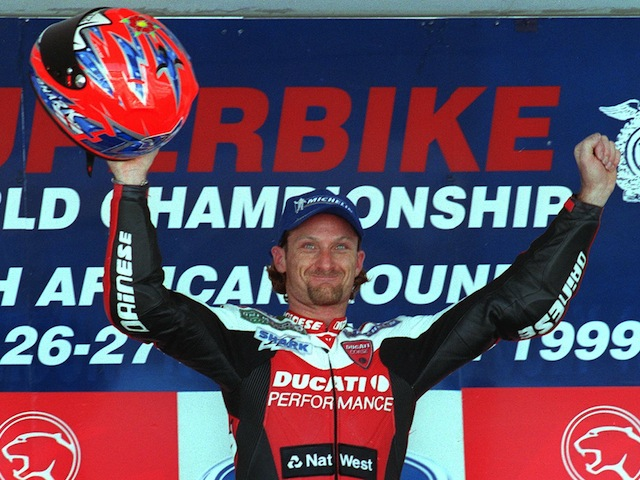 Carl Fogarty celebrates his victory in the first race of the Superbike world championships on the Kyalami racetrack outside Johannesburg on March 28, 1999