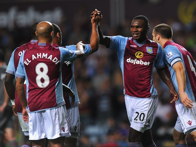Villa players congratulate Christian Benteke following a goal against Rotherham on August 28, 2013