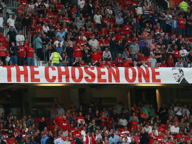 United fans display a banner in the Stretford End stating David Moyes is 'The Chosen One' on August 26, 2013