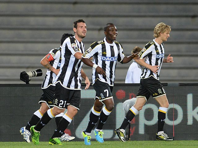 Udinese's Emanuel Badu celebrates with team mates after scoring the opening goal against