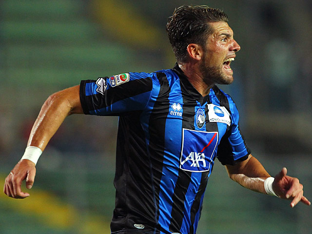 Atalanta 's Guglielmo Stendardo celebrates after scoring the opening goal against Torino on September 1, 2013