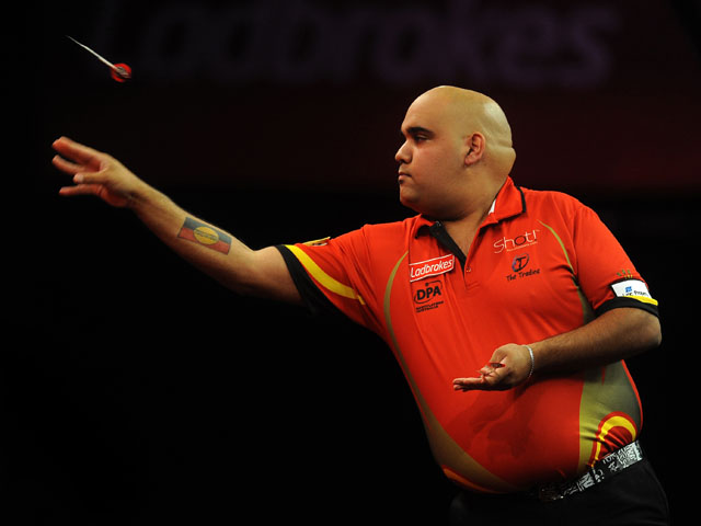 Kyle Anderson of Australia in action during his first round match against Steve Beaton on day five of the Ladbrokes.com World Darts Championship at Alexandra Palace on December 18, 2012