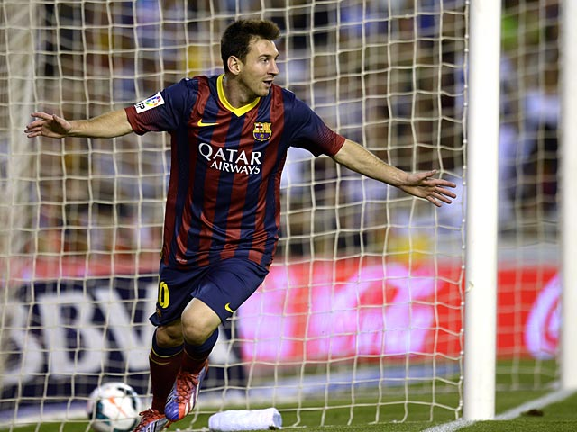 Barcelona's Lionel Messi celebrates after scoring the opening goal during the match against Valencia on September 1, 2013