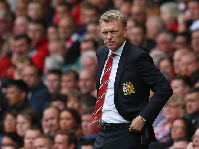 Manchester United Manager David Moyes looks on during the Barclays Premier League match between Liverpool and Manchester United at Anfield on September 01, 2013