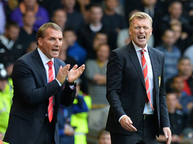 Manchester United's Scottish manager David Moyes reacts next to Liverpool's Northern Irish manager Brendan Rodgers during the English Premier League football match between Liverpool and Manchester United at the Anfield stadium in Liverpool, northwest Engl