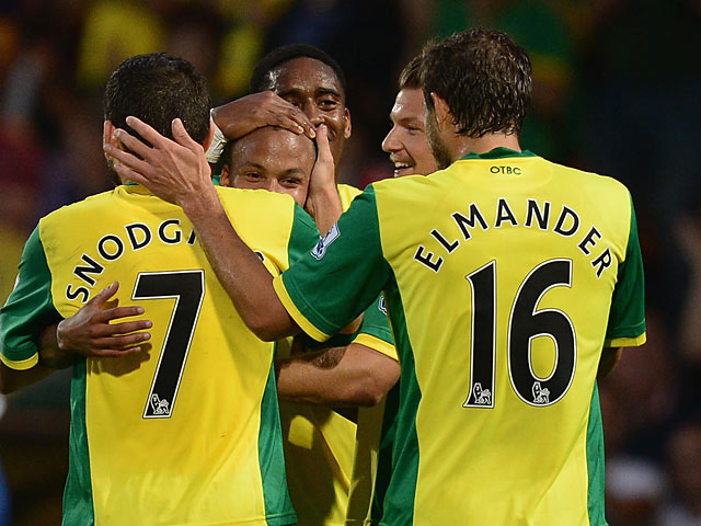 Norwich's Martin Olsson is congratulated by team mates after scoring the opening goal against Bury during their League Cup match on August 27, 2013