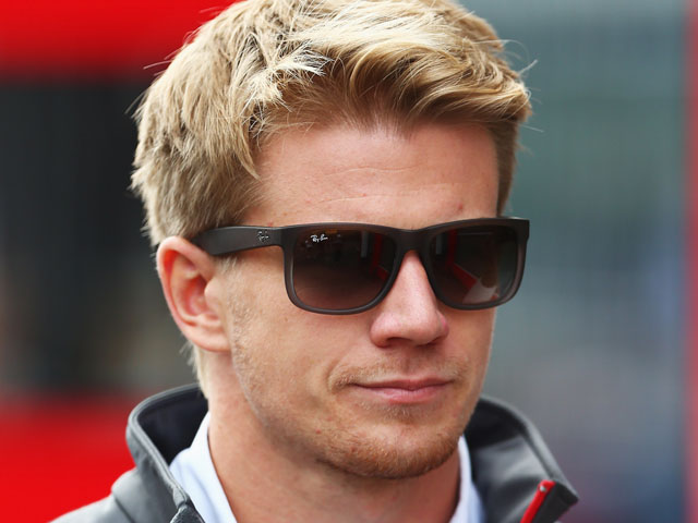 Nico Hulkenberg of Germany and Sauber F1 walks in the paddock before the Belgian Grand Prix at Circuit de Spa-Francorchamps on August 25, 2013