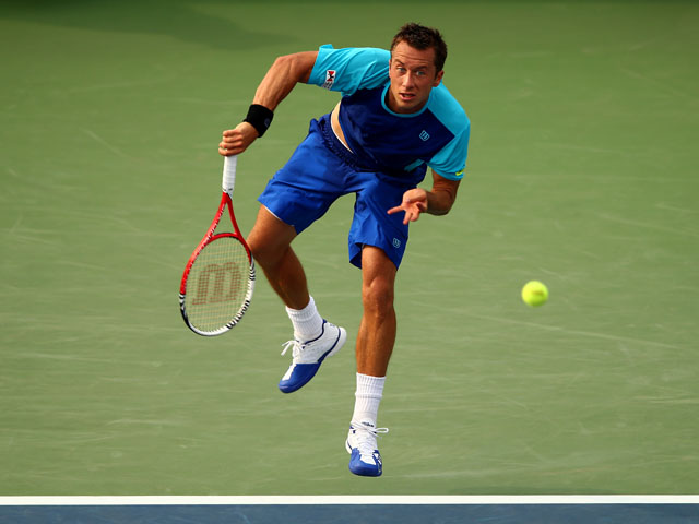 Philipp Kohlschreiber of Germany serves during his men's singles third round match against John Isner of United States of America on Day Six of the 2013 US Open at USTA Billie Jean King National Tennis Center on August 31, 2013
