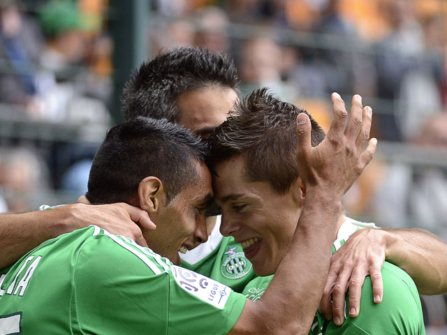 St Etienne's French midfielder Romain Hamouma celebrates with teammate Saint-Etienne's Romanian midfielder Banel Nicolita (L) after scoring a goal during the French L1 football match AS Saint-Etienne vs Bordeaux on September 1st, 2013