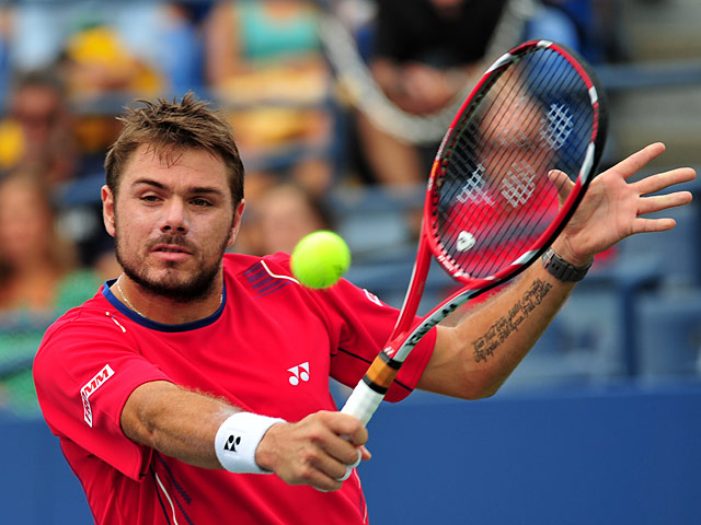 Stanislas Wawrinka in action against Marcos Baghdatis during their US Open third round match on September 1, 2013
