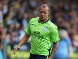 Alan Hutton of Aston Villa in action during the pre season friendly match between Burton Albion and Aston Villa at the Pirelli Stadium on July 14, 2012
