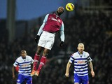 West Ham United's English striker Carlton Cole heads the ball during the English Premier League football match between West Ham United and Queens Park Rangers at the Boleyn Ground, Upton Park, in East London, England, on January 19, 2012