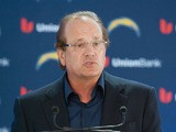 San Diego Chargers Dean Spanos speaks about LaDainian Tomlinson at the announcement of his retirement from professional football, after signing a one-day contract with the San Diego Chargers and being immediately released by the club, on June 18, 2012