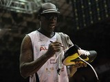 Former US basketball player Dennis Rodman signs autographs for fans during an exhibition event of the NBA Legends team against Bogota's bastketball team Los Piratas, in Bogota, Colombia, on August 8, 2013
