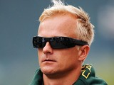 Heikki Kovalainen of Finland and Caterham arrives in the paddock before the final practice session prior to qualifying for the Belgian Grand Prix at Circuit de Spa-Francorchamps on August 24, 2013