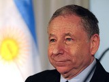 The president of the International Automobile Federation, Jean Todt, arrives for a press conference at the Argentine Automobile Club on August 1, 2013