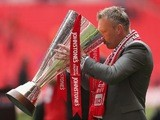 Crewe Alexandra manager Steve Davis celebrates with the Johnstone's Paint Trophy after winning the competition on April 7, 2013