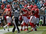 Chiefs players congratulate Junior Hemingway following a touchdown against Jacksonville on September 8, 2013