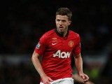 Michael Carrick of Manchester United in action during the Rio Ferdinand Testimonial Match between Manchester United and Sevilla at Old Trafford on August 9, 2013