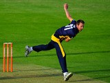 Dragons bowler Michael Hogan in action during the Friends Life T20 match between Glamorgan Dragons and Worcestershire Royals at SWALEC Stadium on July 23, 2013