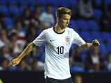 Tom Carroll of England attacks during the 2015 UEFA European U21 Championships Qualifier between England U21 and Moldova U21 at The Madejski Stadium on September 05, 2013