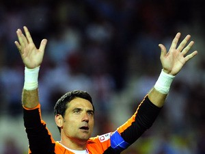 Sevilla's goalkeeper Andres Palop aknowledges applause after the Spanish league football match Sevilla FC Valencia at the Ramon Sanchez Pizjuan stadium in Sevilla, on June 1, 2013