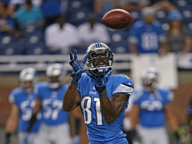 Calvin Johnson #81 of the Detroit Lions warms up prior to the start of the pre-season game against the New York Jets at Ford Field on August 9, 2013