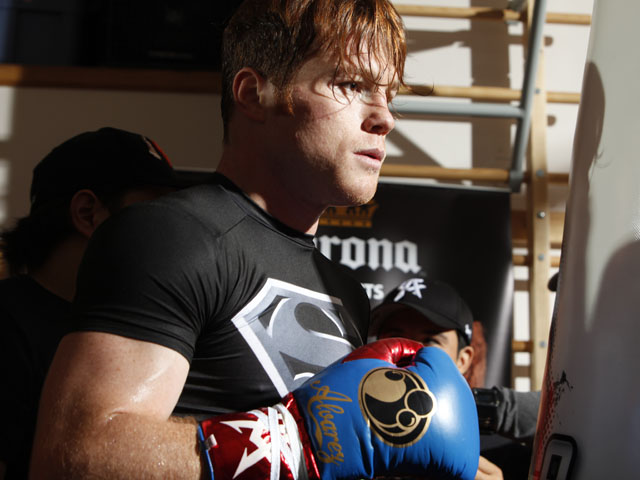 Unified Super Welterweight World Champion Canelo Alvarez holds a media workout on August 27, 2013
