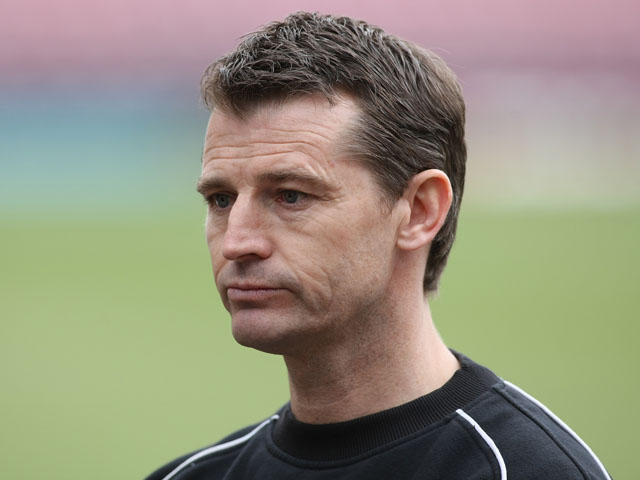 Bradford City assistant manager Colin Cooper looks on prior to the npower League Two match between Bradford City and Northampton Town at The Coral Windows Stadium on March 19, 2011