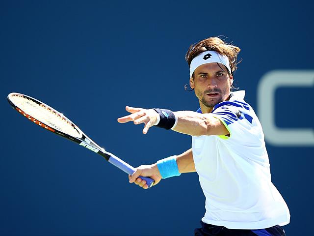David Ferrer in action against Richard Gasquet during their US Open quarter final match on September 4, 2013