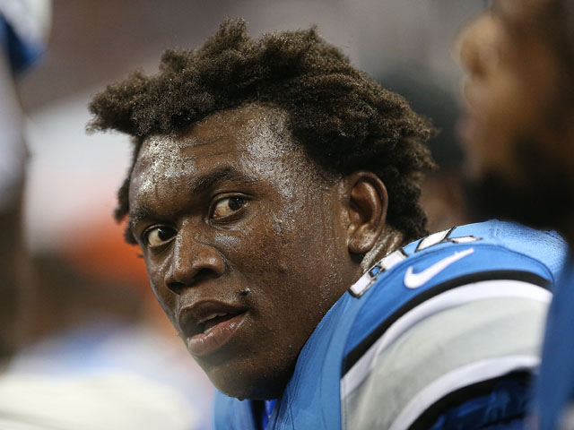 Ezekiel Ansah #94 of the Detroit Lions watches the action from the bench during the pre-season game against the New York Jets at Ford Field on August 9, 2013