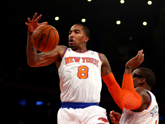 J.R. Smith #8 of the New York Knicks rebounds the ball against the Indiana Pacers during Game Five of the Eastern Conference Semifinals of the 2013 NBA Playoffs at Madison Square Garden on May 16, 2013