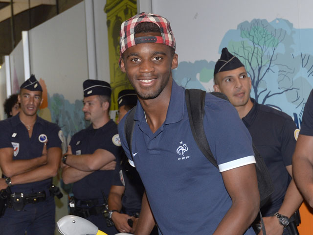 Under-20 French team midfielder Mario Lemina arrives with teammates at the Roissy-Charles-de-Gaulle airport, on July 14, 2013