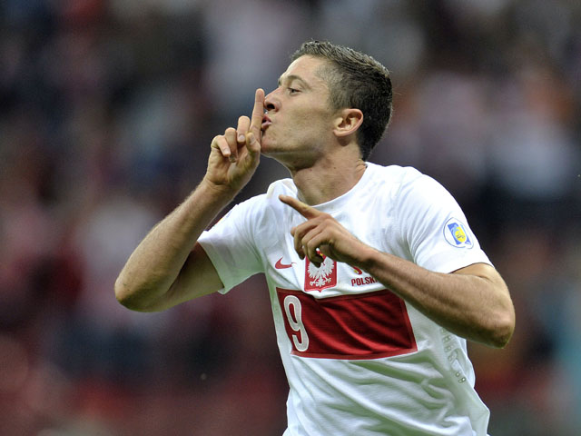Poland's Robert Lewandowski celebrates after scoring during the FIFA 2014 World Cup Qualifier between Poland and Montenegro at the National Stadium on September 06, 2013