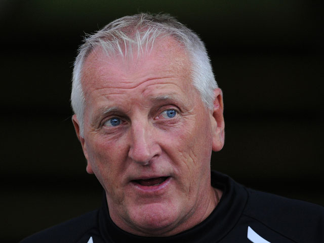 Tranmere Rovers manager Ronnie Moore looks on during the pre season friendly match between Tranmere Rovers and Burnley at Prenton Park on July 23, 2013