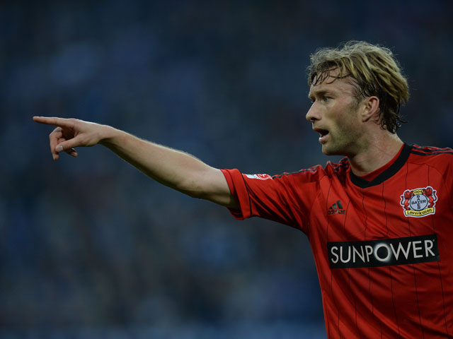 Leverkusen's midfielder Simon Rolfes reacts during the German first division Bundesliga football match FC Schalke 04 vs Bayer Leverkusen in the German city of Gelsenkirchen on April 13, 2013