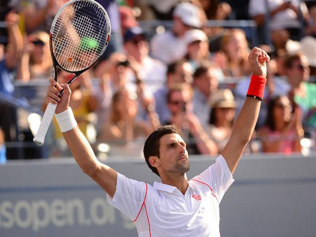 Serbian tennis player Novak Djokovic wins against Switzerland's Stanislas Wawrinka during their 2013 US Open men's semifinals match at the USTA Billie Jean King National Tennis Center in New York on September 7, 2013
